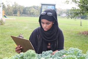 Student in the Blooming Heights Edible Garden